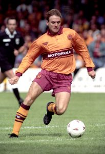 20/08/94 MOTHERWELL V HEARTS (1-1) FIR PARK - MOTHERWELL Motherwell's Tommy Coyne in action